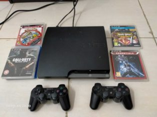 PS3 with two controllers and CD's