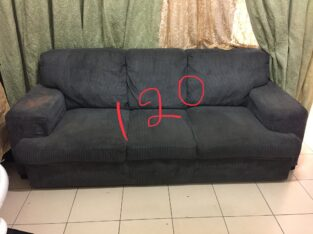3 seater sofa with a rug free